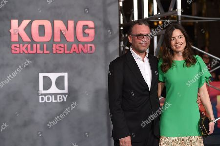 "Henry Jackman, left, and Victoria de la Vega arrive at the Los Angeles premiere of ""Kong: Skull Island"" at the Dolby Theatre on"