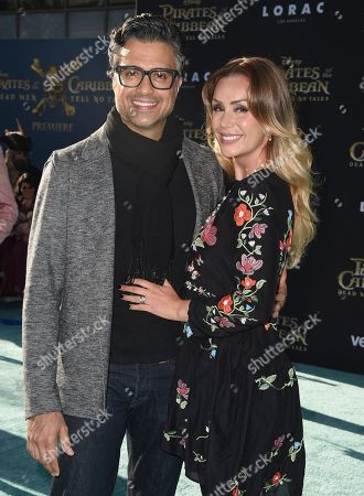 """Jaime Camil, left, and Heidi Balvanera arrive at the Los Angeles premiere of """"Pirates of the Caribbean: Dead Men Tell No Tales"""" at the Dolby Theatre on"""