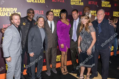 """David Spade, from left, Arsenio Hall, Rob Schneider, Jennifer Hudson, Adam Sandler, Jane Seymour, Terry Crews, and Sandy Wernick arrive at the LA Premiere of """"Sandy Wexler"""" at the Arclight Hollywood, in Los Angeles"""