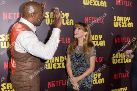 """Terry Crews, left, and Jane Seymour arrive at the LA Premiere of """"Sandy Wexler"""" at the Arclight Hollywood, in Los Angeles"""