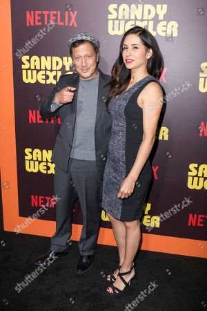 "Stock Picture of Rob Schneider, left, and Patricia Maya arrive at the LA Premiere of ""Sandy Wexler"" at the Arclight Hollywood, in Los Angeles"