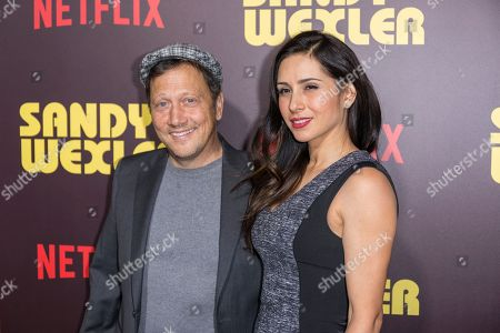"Rob Schneider, left, and Patricia Maya arrive at the LA Premiere of ""Sandy Wexler"" at the Arclight Hollywood, in Los Angeles"
