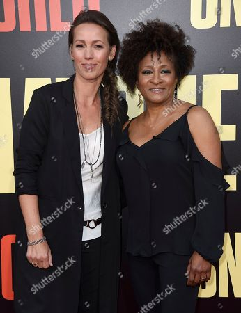 """Alex Sykes, left, and Wanda Sykes arrive at the Los Angeles premiere of """"Snatched"""" at the Regency Village Theatre on"""
