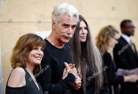"""Sam Elliott, star of """"The Hero,"""" arrives with his wife Katharine Ross, left, and their daughter Cleo Rose Elliott at the premiere of the film at the Egyptian Theatre, in Los Angeles"""