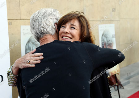 "Sam Elliott, star of ""The Hero,"" embraces actress Anne Archer at the premiere of the film at theEgyptian Theatre, in Los Angeles"