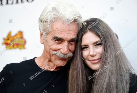 """Sam Elliott, star of """"The Hero,"""" poses with his daughter Cleo Rose Elliott at the premiere of the film at the Egyptian Theatre, in Los Angeles"""