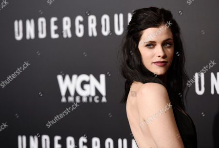 """Jessica de Gouw, a cast member in """"Underground,"""" poses at the season two premiere of the television series, in Los Angeles"""