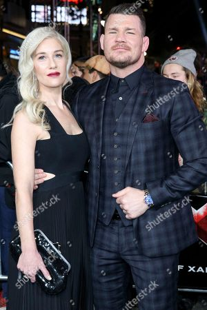 """Michael Bisping, right, and Rebecca Bisbing arrive at the LA Premiere of """"xXx: Return of Xander Cage"""" at TCL Chinese Theater IMAX, in Los Angeles"""