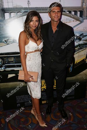 "Christian Meier, right, and guest arrive at the Los Angeles Special Screening of ""Lowriders"" at the L.A. Live on"