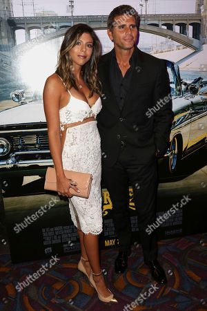 "Christian Meier, right, and Alondra Garcia Miro arrive at the Los Angeles Special Screening of ""Lowriders"" at the L.A. Live on"