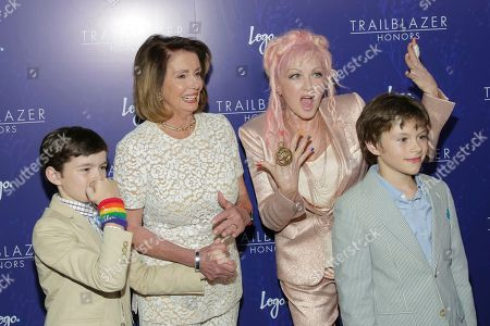 Thomas Vos, from left, Congresswoman Nancy Pelosi, event honoree Cyndi Lauper and Paul Vos attend LOGO's Trailblazer Honors, celebrating leaders at the forefront of LGBTQ equality, at The Cathedral of St. John the Divine, in New York