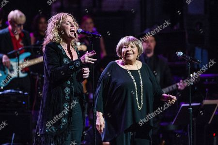 Amy Helm, left, and Mavis Staples perform at Love Rocks NYC! at the Beacon Theatre on in New York