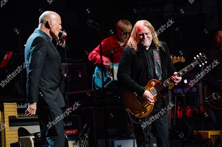 Bruce Willis, left, and Warren Haynes perform at Love Rocks NYC! at the Beacon Theatre on in New York