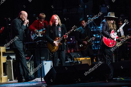 Bruce Willis, from left, Warren Haynes and Marcus King perform at Love Rocks NYC! at the Beacon Theatre on in New York