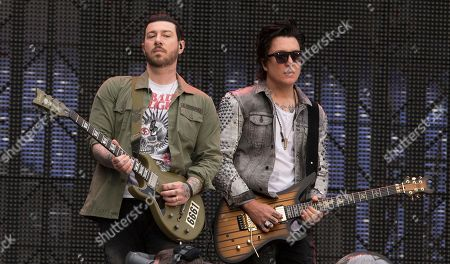 """Zacky Vengeance, left, and Synyster Gates of the band Avenged Sevenfold performs in concert as the opening act for Metallica during their """"WorldWired Tour"""" at M&T Bank Stadium, in Baltimore"""