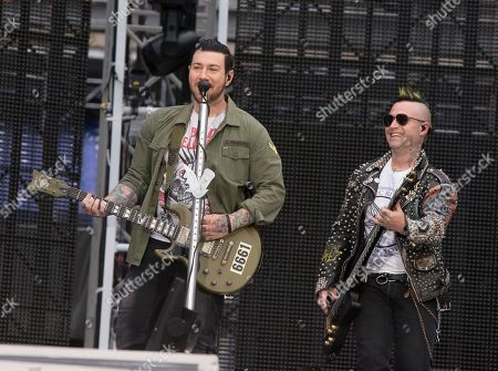 """Zacky Vengeance, left, and Johnny Christ of the band Avenged Sevenfold performs in concert as the opening act for Metallica during their """"WorldWired Tour"""" at M&T Bank Stadium, in Baltimore"""