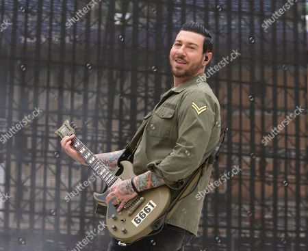 """Zacky Vengeance of the band Avenged Sevenfold performs in concert as the opening act for Metallica during their """"WorldWired Tour"""" at M&T Bank Stadium, in Baltimore"""