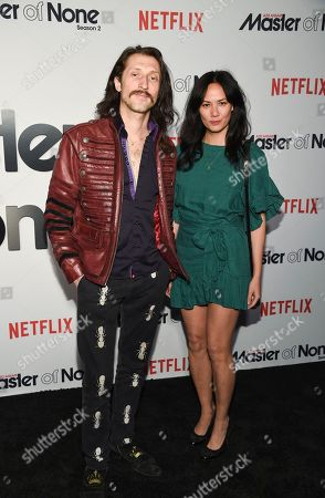 """Musicians Eugene Hutz, left, and Pamela Racine from the band Gogol Bordello attend Netflix's """"Master of None"""" season two premiere at the SVA Theatre, in New York"""