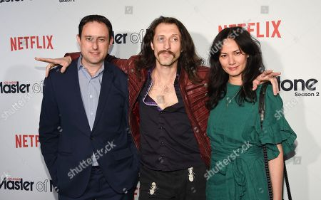 """Producer Igor Srubshcik, left, poses with musicians Eugene Hutz and Pamela Racine at Netflix's """"Master of None"""" season two premiere at the SVA Theatre, in New York"""