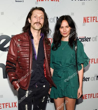 """Stock Picture of Musicians Eugene Hutz, left, and Pamela Racine from the band Gogol Bordello attend Netflix's """"Master of None"""" season two premiere at the SVA Theatre, in New York"""