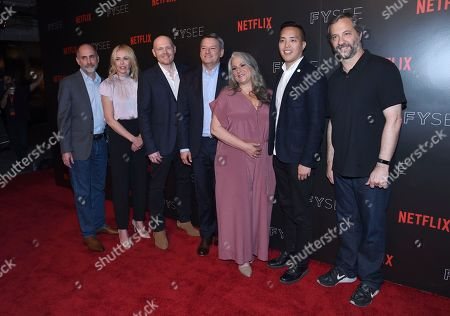 Victor Fresco, from left, Chelsea Handler, Bill Burr, Netflix CCO Ted Sarandos, Marta Kauffman, Alan Yang and Judd Apatow arrive at the Netflix Comedy Panel For Your Consideration Event at the Netflix FYSee Space, in Beverly Hills, Calif