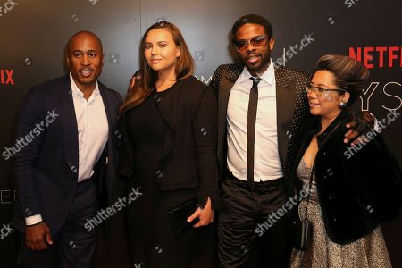 Ali Shaheed Muhammad, left, Adrian Younge, second right, and guests arrive at the Netflix FYSee Kick-Off Event, in Beverly Hills, Calif