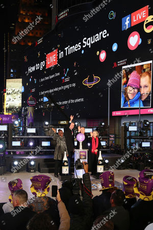 Stock Picture of Chirlane McCray, from left, Mayor Bill de Blasio, United Nations Secretary-General Ban Ki-moon and wife Yoo Soon-taek celebrate New Year's Eve in Times Square, in New York
