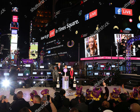 Chirlane McCray, from left, Mayor Bill de Blasio, United Nations Secretary-General Ban Ki-moon and wife Yoo Soon-taek celebrate New Year's Eve in Times Square, in New York