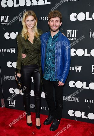 """Timo Weiland, right, and Emily Senko attend the premiere of """"Colossal"""" at AMC Loews Lincoln Square on Tuesday, March, 28, 2017, in New York"""