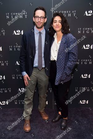 "Stock Image of Producers David Kaplan, left, and Andrea Roa attend the premiere of ""It Comes at Night"" at Metrograph, in New York"