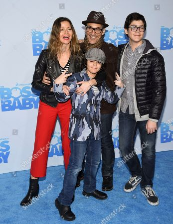 "Actress Jill Hennessy and husband Paolo Mastropietro pose with their sons Gianni and Marco at the premiere of ""The Boss Baby"" at AMC Loews Lincoln Square, in New York"