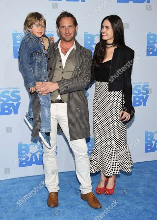"""Actor Josh Lucas and ex-wife Jessica Ciencin Henriquez pose with their son Noah at the premiere of """"The Boss Baby"""" at AMC Loews Lincoln Square, in New York"""