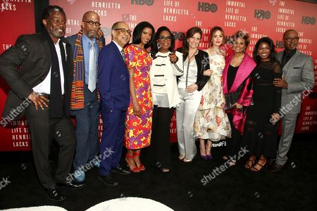 """John Douglas Thompson, from left, Reg E. Cathey, George C. Wolfe, Renee Elise Goldsberry, Oprah Winfrey, Rose Byrne, Leslie Uggams, Kyanna Simpson and Courtney B. Vance attend the premiere of HBO Films' """"The Immortal Life of Henrietta Lacks"""" at the SVA Theatre, in New York"""