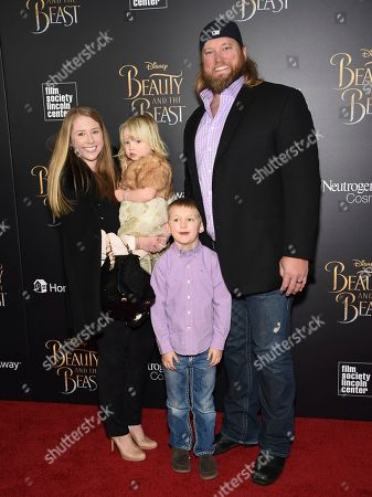 """Professional football player Nick Mangold and family attend a special screening of Disney's """"Beauty and the Beast"""" at Alice Tully Hall, in New York"""