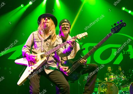 C.C. DeVille, left, and Bobby Dall of the band Poison perform in concert at the Royal Farms Arena, in Baltimore