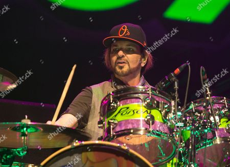 Stock Picture of Rikki Rockett of the band Poison performs in concert at the Royal Farms Arena, in Baltimore