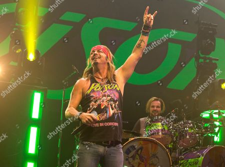 Bret Michaels, left, and Rikki Rockett of the band Poison perform in concert at the Royal Farms Arena, in Baltimore