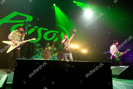 C.C. DeVille, left, Rikki Rockett, Bret Michaels and Bobby Dall of the band Poison perform in concert at the Royal Farms Arena, in Baltimore