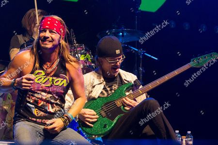Bret Michaels, left, and Bobby Dall of the band Poison perform in concert at the Royal Farms Arena, in Baltimore