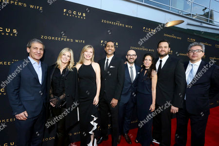 """Executive Producer Michael Tollin, Executive Producer Robbie Rowe Tollin, Producer Kim Zubick, Abhijay Prakash, COO, Focus Features, Peter Kujawski, Chairman, Focus Features, Producer Diane Miller Levin, Producer Jamie Patricof and Producer Jeff Abberley seen at Los Angeles Premiere of Focus Features' """"The Zookeeper's Wife"""" at ArcLight Hollywood, in Los Angeles"""
