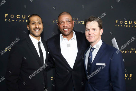 "Abhijay Prakash, COO, Focus Features, Doc Rivers and Jason Cassidy, President of Marketing, Focus Features, seen at Los Angeles Premiere of Focus Features' ""The Zookeeper's Wife"" at ArcLight Hollywood, in Los Angeles"