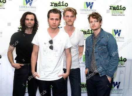 Sean Cimino, from left, Mark Foster, Mark Pontius and Isom Innis of the band Foster The People pose for photographers backstage during night two of the Radio 104.5 10th Birthday Show at BB&T Pavilion, in Camden, N.J