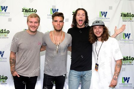 Daniel Kristjansson, from left, JJ Julius Son, Rubin Pollock and David Antonsson of the band Kaleo pose for photographers backstage during night two of the Radio 104.5 10th Birthday Show at BB&T Pavilion, in Camden, N.J