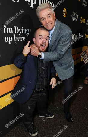 """Brad Williams, left, and Tom Dreesen are pictured at Showtime's """"I'm Dying Up Here"""" premiere at the Directors Guild of America Theater, in Los Angeles"""