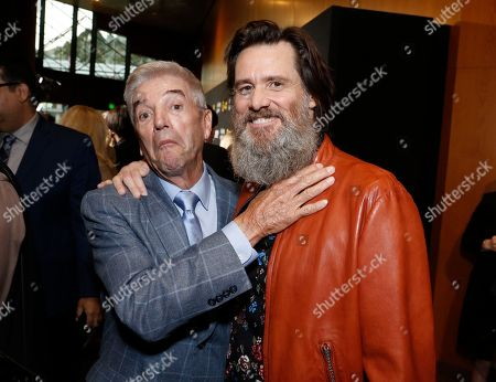 """Stock Image of Tom Dreesen, left, and Jim Carrey are pictured at Showtime's """"I'm Dying Up Here"""" premiere at the Directors Guild of America Theater, in Los Angeles"""