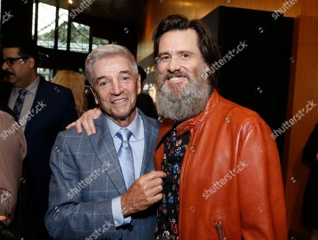 """Stock Picture of Tom Dreesen, left, and Jim Carrey are pictured at Showtime's """"I'm Dying Up Here"""" premiere at the Directors Guild of America Theater, in Los Angeles"""