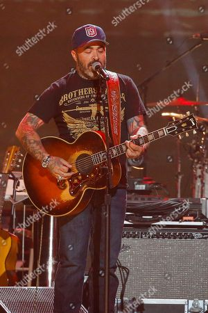 "Stock Picture of Aaron Lewis, left, and Ben Haggard perform at the concert ""Sing me Back Home: The Music of Merle Haggard"" at the Bridgestone Arena, in Nashville, Tenn"