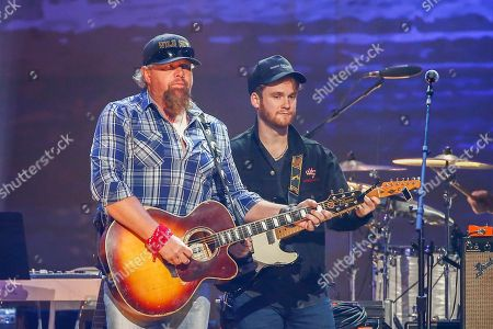 "Toby Keith, left, and Ben Haggard perform at the concert ""Sing me Back Home: The Music of Merle Haggard"" at the Bridgestone Arena, in Nashville, Tenn"
