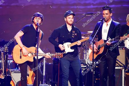 "Chris Janson, left, Ben Haggard, and Jake Owen perform at the concert ""Sing me Back Home: The Music of Merle Haggard"" at the Bridgestone Arena, in Nashville, Tenn"