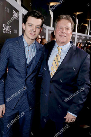"Stock Picture of Asa Butterfield and Writer/Producer Richard Barton Lewis seen at STX Entertainment Los Angeles Special Screening of ""The Space Between Us"" at ArcLight Hollywood, in Los Angeles"